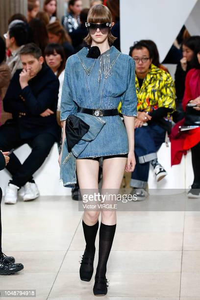 A model walks the runway during the Miu Miu show as part of the Paris Fashion Week Womenswear Spring/Summer 2019 on October 2 2018 in Paris France