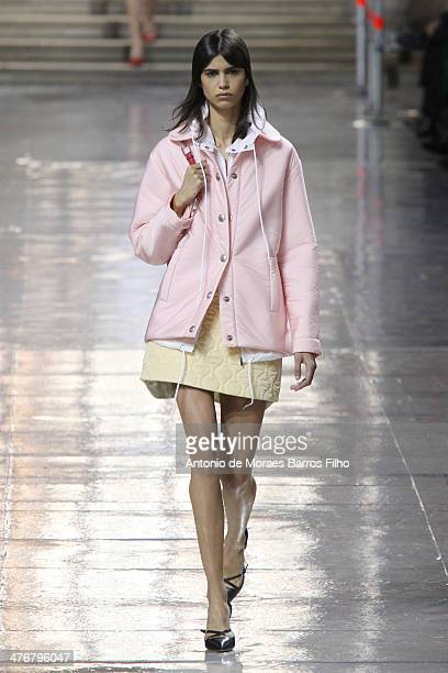 A model walks the runway during the Miu Miu show as part of the Paris Fashion Week Womenswear Fall/Winter 20142015 on March 5 2014 in Paris France