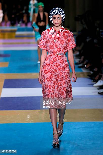 A model walks the runway during the Miu Miu show as part of the Paris Fashion Week Womenswear Spring/Summer 2017 on October 5 2016 in Paris France
