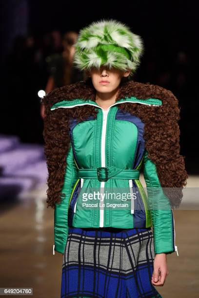A model walks the runway during the Miu Miu show as part of the Paris Fashion Week Womenswear Fall/Winter 2017/2018 on March 7 2017 in Paris France