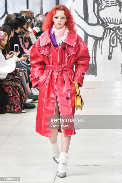 A model walks the runway during the Miu Miu show as part of the Paris Fashion Week Womenswear Fall/Winter 2018/2019 on March 6 2018 in Paris France
