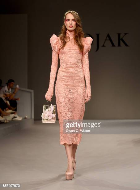 A model walks the runway during the Mohanad Kojak show at Fashion Forward October 2017 held at the Dubai Design District on October 28 2017 in Dubai...