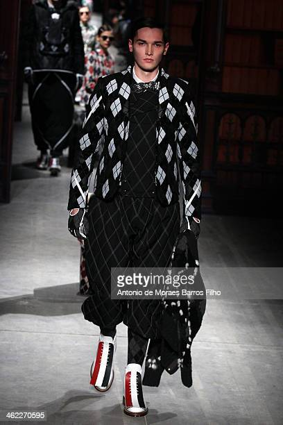 A model walks the runway during the Moncler Gamme Bleu show as a part of Milan Fashion Week Menswear Autumn/Winter 2014 on January 12 2014 in Milan...