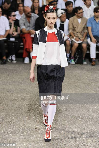 A model walks the runway during the Moncler Gamme Bleu show as part of Milan Fashion Week Menswear Spring/Summer 2015 on June 22 2014 in Milan Italy