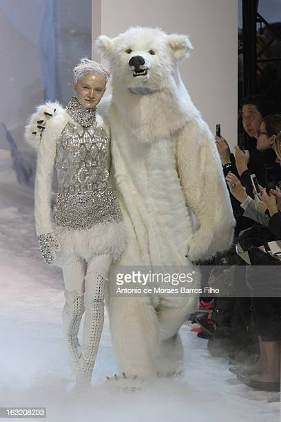 Model walks the runway during the Moncler Gamme Rouge Fall/Winter 2013 Ready-to-Wear show as part of Paris Fashion Week on March 6, 2013 in Paris,...