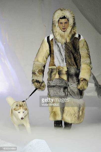 A model walks the runway during the Moncler Gamme Rouge Fall/Winter 2013/14 ReadytoWear show as part of Paris Fashion Week on March 6 2013 in Paris...