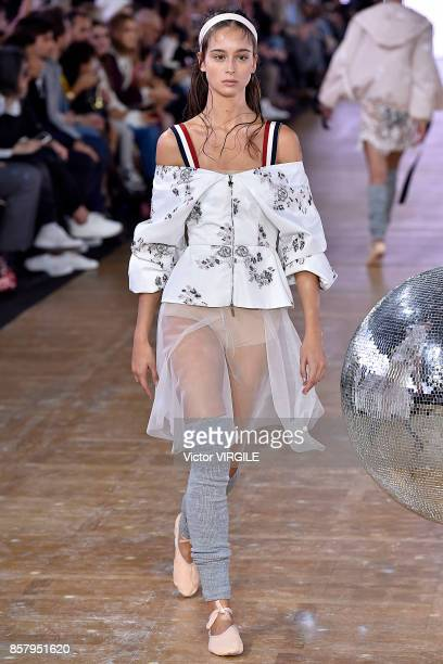 A model walks the runway during the Moncler Gamme Rouge Ready to Wear Spring/Summer 2018 fashion show as part of the Paris Fashion Week Womenswear...