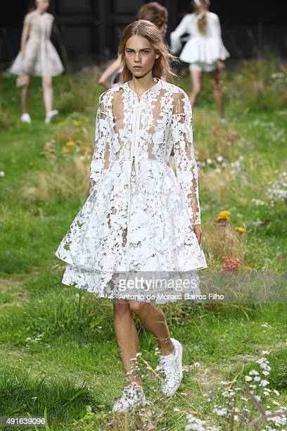 A model walks the runway during the Moncler Gamme Rouge show as part of the Paris Fashion Week Womenswear Spring/Summer 2016 on October 7 2015 in...