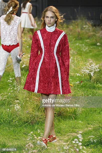 Model walks the runway during the Moncler Gamme Rouge show as part of the Paris Fashion Week Womenswear Spring/Summer 2016 on October 7, 2015 in...