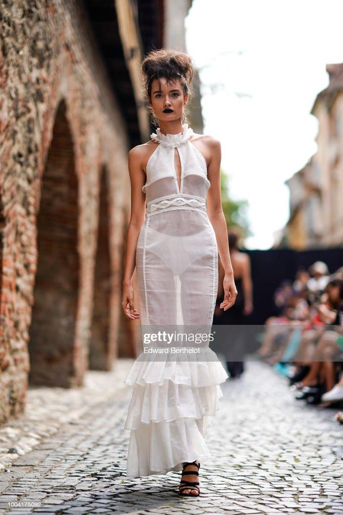 A model walks the runway during the Mondovi show, at Strada Cetatii, during Feeric Fashion Week 2018, on July 21, 2018 in Sibiu, Romania.