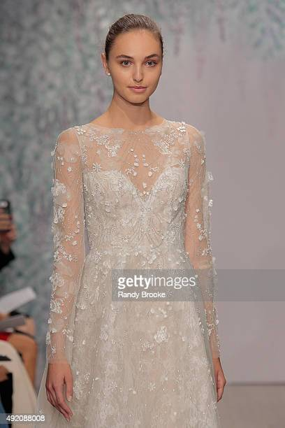 A model walks the runway during the Monique Lhuillier Bridal Fall/Winter 2016 Runway Show on October 9 2015 in New York City