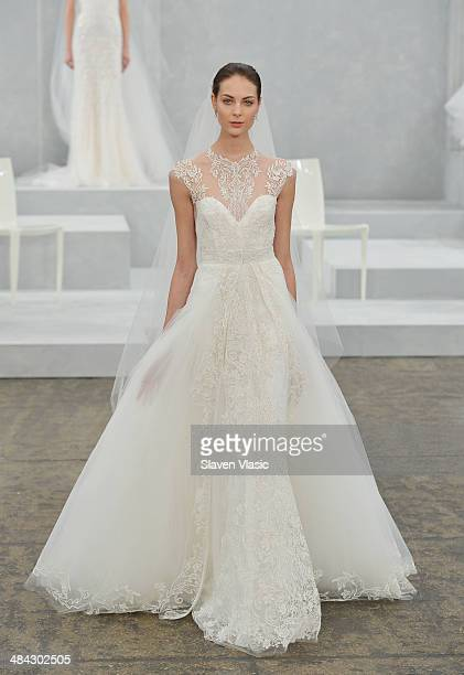 A model walks the runway during the Monique Lhuillier Spring 2015 Bridal collection show on April 11 2014 in New York City