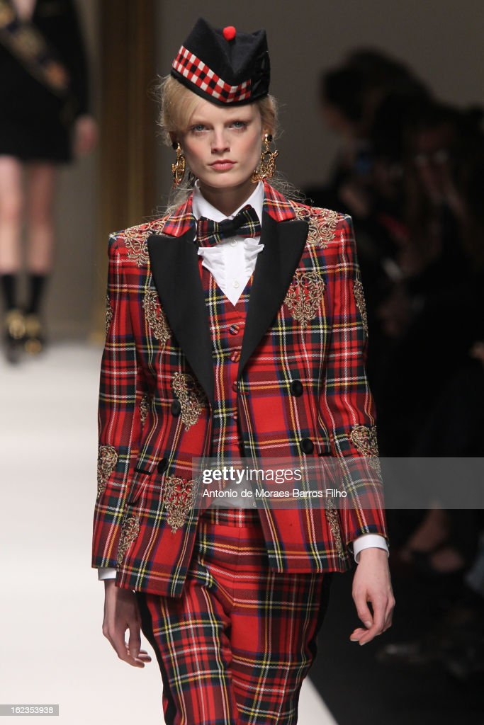 A model walks the runway during the Moschino show as a part of Milan Fashion Week Fall/Winter 2013/14 on February 22, 2013 in Milan, Italy.