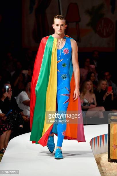 A model walks the runway during the Moschino Spring/Summer 19 Menswear and Women's Resort Collection at Los Angeles Equestrian Center on June 8 2018...