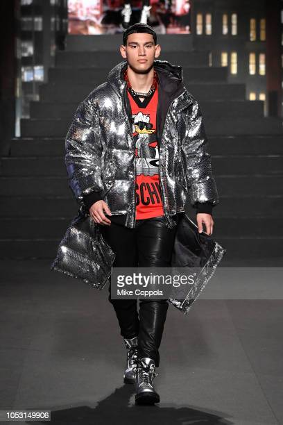 A model walks the runway during the Moschino x HM Runway at Pier 36 on October 24 2018 in New York City