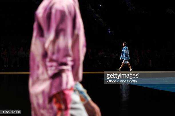 A model walks the runway during the MSGM fashion show at Pitti Immagine Uomo 96 on June 13 2019 in Florence Italy
