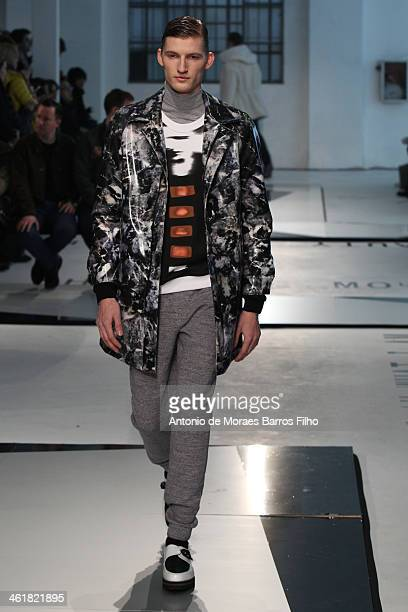 Model walks the runway during the MSGM show as a part of Milan Fashion Week Menswear Autumn/Winter 2014 on January 11, 2014 in Milan, Italy.