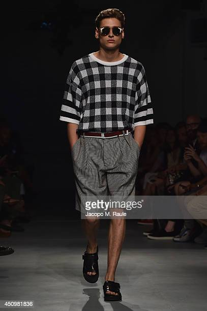 Model walks the runway during the MSGM show as part of Milan Fashion Week Menswear Spring/Summer 2015 on June 21, 2014 in Milan, Italy.