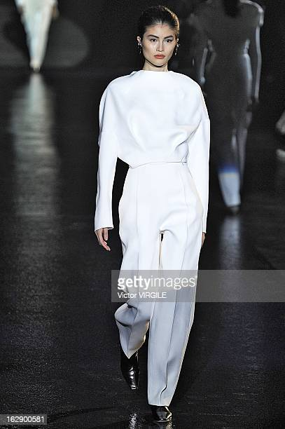 A model walks the runway during the Mugler Fall/Winter 2013/14 ReadytoWear show as part of Paris Fashion Week on February 27 2013 in Paris France