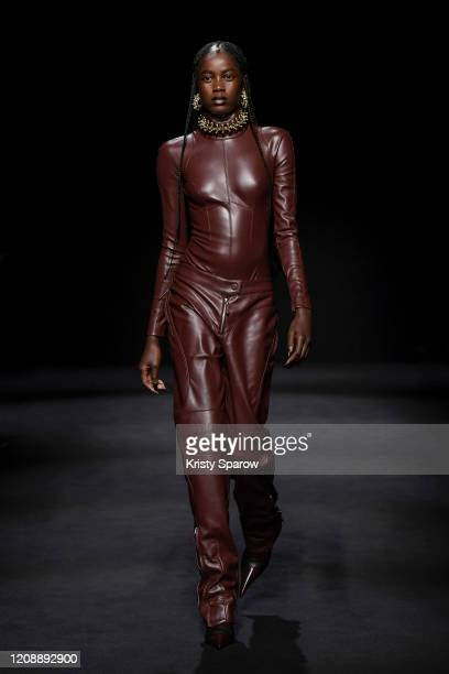 A model walks the runway during the Mugler show as part of Paris Fashion Week Womenswear Fall/Winter 2020/2021 on February 26 2020 in Paris France