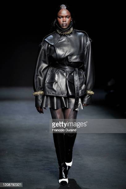 A model walks the runway during the Mugler show as part of the Paris Fashion Week Womenswear Fall/Winter 2020/2021 on February 26 2020 in Paris France