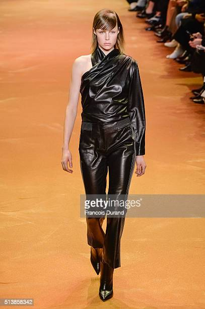 A model walks the runway during the Mugler show as part of the Paris Fashion Week Womenswear Fall/Winter 2016/2017 on March 5 2016 in Paris France