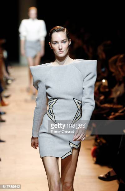 A model walks the runway during the Mugler show as part of the Paris Fashion Week Womenswear Fall/Winter 2017/2018 on March 4 2017 in Paris France