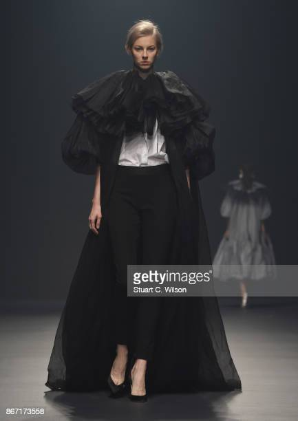 A model walks the runway during the Nabil Nayal show at Fashion Forward October 2017 held at the Dubai Design District on October 27 2017 in Dubai...