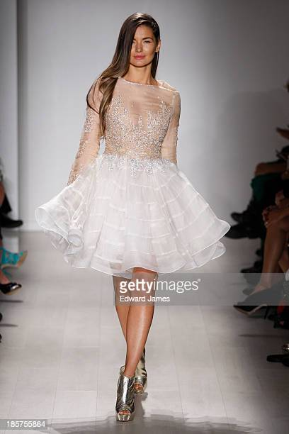 Model walks the runway during the Narces fashion show at David Pecaut Square on October 24, 2013 in Toronto, Canada.