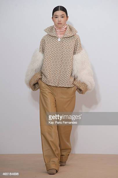 A model walks the runway during the Nehera show as part of the Paris Fashion Week Womenswear Fall/Winter 2015/2016 on March 3 2015 in Paris France