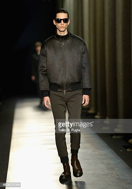 A model walks the runway during the Neil Barrett show as a part of Milan Fashion Week Menswear Autumn/Winter 2014 on January 11 2014 in Milan Italy