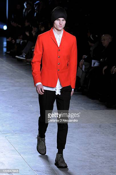 A model walks the runway during the Neil Barrett show as part of Milan Fashion Week Autumn/Winter 2009/2010 Menswear on January 18 2009 in Milan Italy