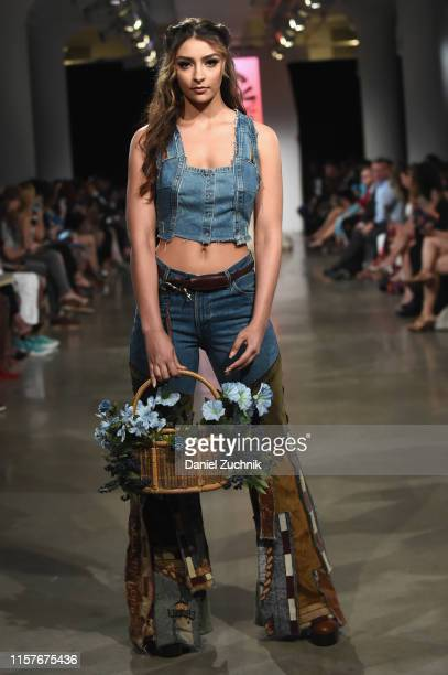 Model walks the runway during the New York Summer Fashion Explosion hosted by Teresa Giudice on June 22, 2019 in New York City.