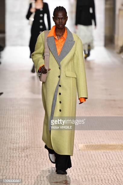 Model walks the runway during the Nina Ricci Ready to Wear fashion show as part of the Paris Fashion Week Womenswear Fall/Winter 2020-2021 on...