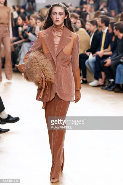 A model walks the runway during the Nina Ricci Ready to Wear fashion show as part of the Paris Fashion Week Womenswear Fall/Winter 2017/2018 on March...