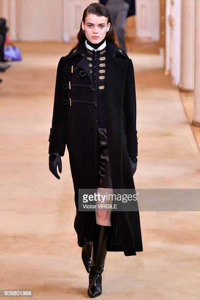 A model walks the runway during the Nina Ricci Ready to Wear fashion show as part of the Paris Fashion Week Womenswear Fall/Winter 2018/2019 on March...