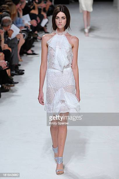 A model walks the runway during the Nina Ricci show as part of Paris Fashion Week Womenswear Spring/Summer 2014 on September 26 2013 in Paris France