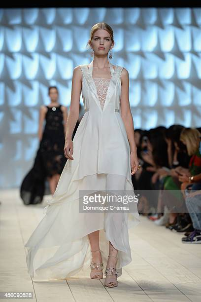A model walks the runway during the Nina Ricci show as part of the Paris Fashion Week Womenswear Spring/Summer 2015 on September 25 2014 in Paris...