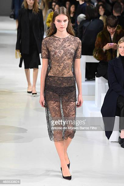 A model walks the runway during the Nina Ricci show as part of the Paris Fashion Week Womenswear Fall/Winter 2015/2016 on March 7 2015 in Paris France