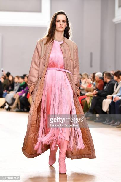 A model walks the runway during the Nina Ricci show as part of the Paris Fashion Week Womenswear Fall/Winter 2017/2018 on March 4 2017 in Paris France