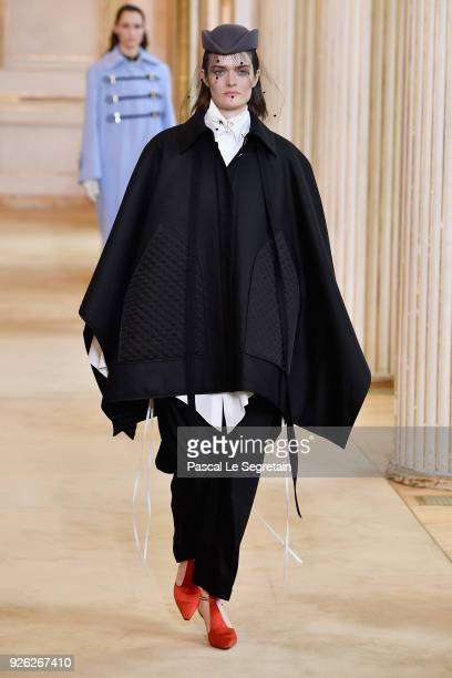A model walks the runway during the Nina Ricci show as part of the Paris Fashion Week Womenswear Fall/Winter 2018/2019 on March 2 2018 in Paris France