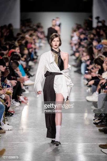 A model walks the runway during the Ninamounah show at Moda Lisboa Awake 2020 on March 08 2020 in Lisboa Portugal