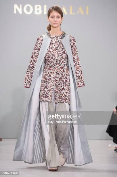 A model walks the runway during the Nobi Talai Paris show as part of the Paris Fashion Week Womenswear Spring/Summer 2018 on October 2 2017 in Paris...
