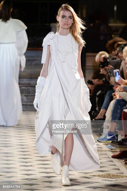 A model walks the runway during the Nobi Talai show as part of the Paris Fashion Week Womenswear Fall/Winter 2017/2018 on March 7 2017 in Paris France