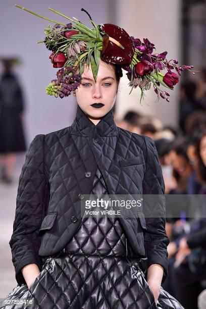 A model walks the runway during the Noir Kei Ninomiya Ready to Wear fashion show as part of the Paris Fashion Week Womenswear Fall/Winter 2018/2019...