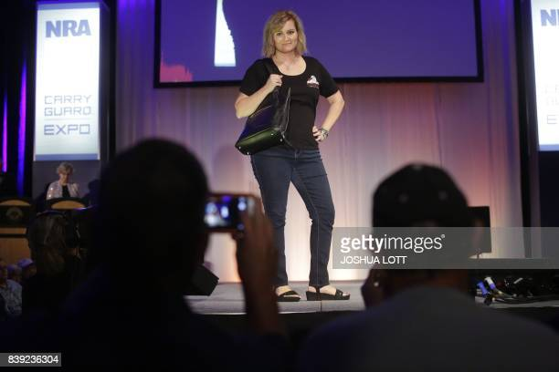 A model walks the runway during the NRA Concealed Carry Fashion Show on Friday August 25 2017 in Milwaukee Wisconsin