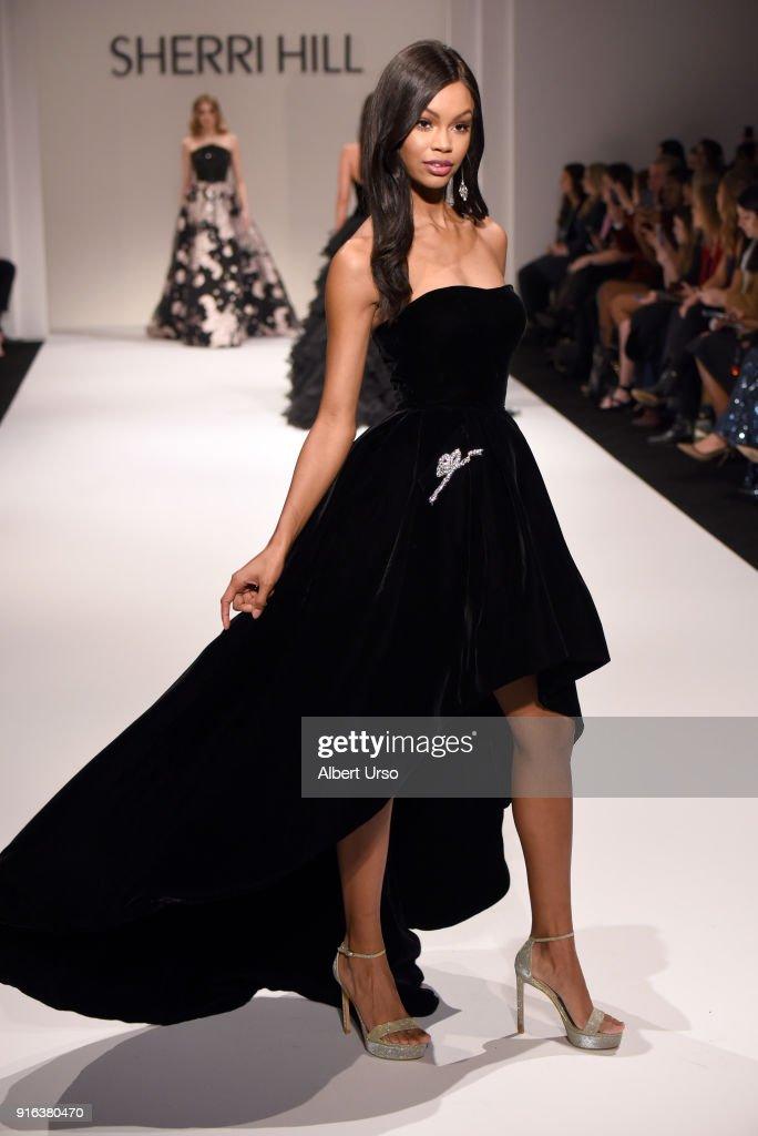 A model walks the runway during the NYFW Sherri Hill Runway Show on February 9, 2018 in New York City.