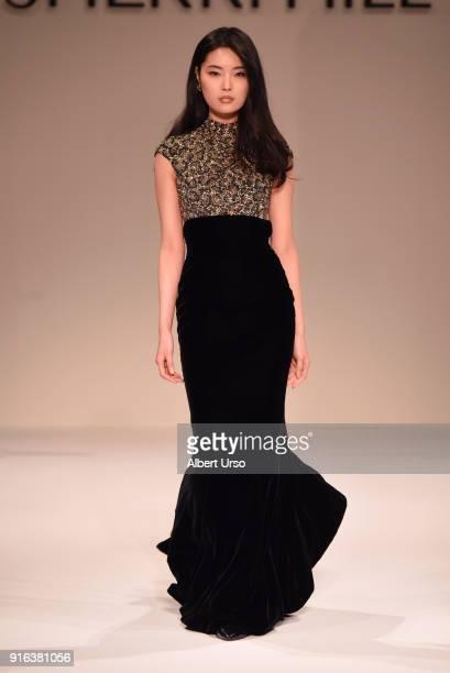 A model walks the runway during the NYFW Sherri Hill Runway Show on February 9 2018 in New York City