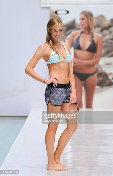 A model walks the runway during the Oakley fashion show at MercedesBenz Fashion Week Swim 2014 Runway at the SLS Hotel on July 21 2013 in Miami...