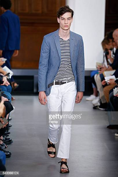 Model walks the runway during the Officine Generale Menswear Spring/Summer 2017 show designed by Pierre Mahéo as part of Paris Fashion Week on June...